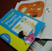 play phonics games using books, newspapers and magazines