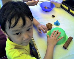 child making play dough craft